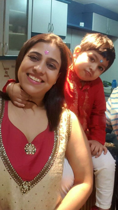 """""""Motherhood to me means doing just anything to make my son smile,laugh andhave a great time together always. Even if that means letting him put a startsticker on the forehead and pose, as you see in this picture."""" -Shikha"""